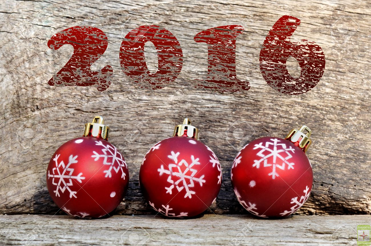 2016 red and christmas balls on wooden background